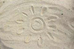 Sun drawing in the sand Stock Photo