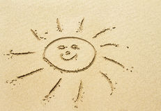 Sun drawing on sandy beach Stock Photography