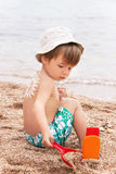 The sun drawing sunscreen on baby (boy)  back. Stock Photography