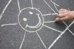 Sun drawn on asphalt Stock Photo