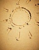 Sun drawn on sand Stock Photography