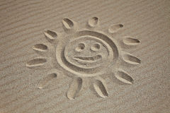 Sun drawn in the sand Royalty Free Stock Photos