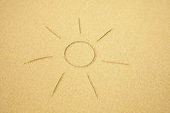Sun drawn on sand of the beach Royalty Free Stock Images