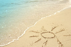 Sun drawn in the sand on the seashore Royalty Free Stock Image