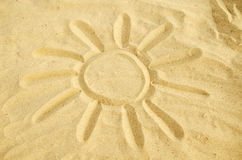 Sun drawn in the sand. Sun symbol drawn in the sand. yellow sand, sunny day Stock Image