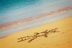 Sun drawn on sandy beach Stock Image
