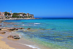 Sun-drenched Algajola, Corsica. Colorful village of Algajola by the Mediterranean on the northern coast of Corsica, France Stock Image