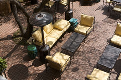 Sun drenched european veranda seating area Royalty Free Stock Photo