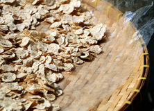 Sun dried banana slices on the threshing basket Stock Photos