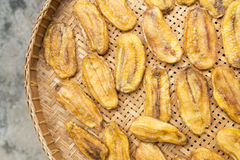 Sun-dried banana Top view. Sun-dried banana on the wooden sieve Royalty Free Stock Images