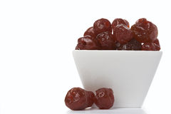 Sun-dried cherries. In a white vase Stock Photography