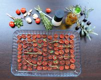 Sun-dried cherry tomatoes with spices and olive oil Stock Photo