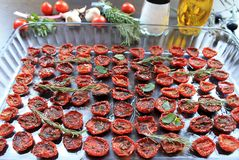 Sun-dried cherry tomatoes with spices and olive oil Royalty Free Stock Image