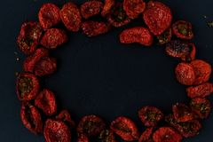 Sun dried tomatoes on a black background Stock Images