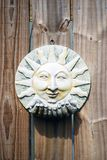 Sun Dried Fance. Sun worn sun ceramic hanging on a wooden fence Stock Images