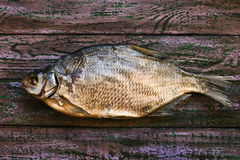 Sun dried fish on the purple wooden background Royalty Free Stock Images