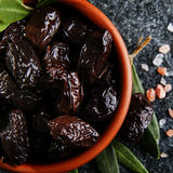 Sun-dried olives in bowl Royalty Free Stock Images