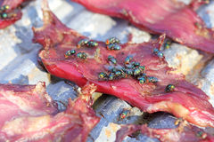 Sun-dried pork with flies. Out door Stock Photo