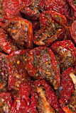 Sun dried red tomatoes  background Stock Images