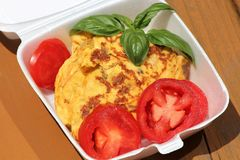 Sun-Dried Tomato and Basil Omelet in To Go or Carry Out or Take Away Box Stock Photography