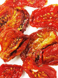 Sun dried tomatoes. A plate of sun dried tomatoes Royalty Free Stock Photography