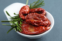 Sun-dried tomatoes. And rosemary in a small bowl Royalty Free Stock Photo