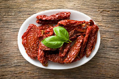Sun dried tomatoes and basil Stock Photography