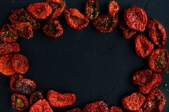 Sun dried tomatoes on a black background Royalty Free Stock Photography