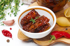 Sun dried tomatoes in a bowl and spices close-up Royalty Free Stock Image
