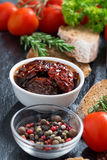 Sun-dried tomatoes in a bowl and various appetizers Royalty Free Stock Image