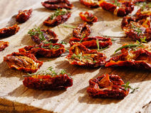 Sun dried tomatoes. Close up of tomatoes drying in the sun Royalty Free Stock Photography