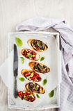 Sun dried tomatoes, cream cheese and fried mushrooms bruschetta. Top view royalty free stock images