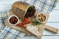 Sun-dried tomatoes, fresh tomatoes, bread and mussels Royalty Free Stock Image