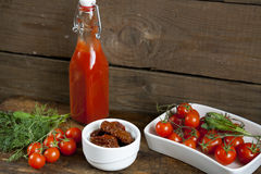 Sun-dried tomatoes, fresh tomatoes and tomato puree Stock Images