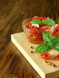 Sun-dried tomatoes with garlic, basil and spices Royalty Free Stock Photo