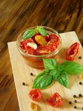 Sun-dried tomatoes with garlic, basil and spices Royalty Free Stock Image