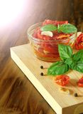 Sun-dried tomatoes with garlic, basil and spices Royalty Free Stock Photography