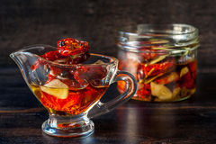 Sun-dried tomatoes with garlic Stock Image