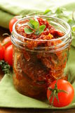 Sun-dried tomatoes with herbs Stock Photography