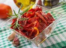 Sun-dried tomatoes with herbs Royalty Free Stock Photos