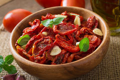 Sun-dried tomatoes with herbs and garlic Royalty Free Stock Photo