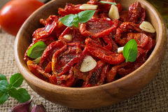 Sun-dried tomatoes with herbs and garlic Stock Photography