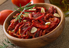Sun-dried tomatoes with herbs and garlic Royalty Free Stock Photography