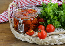 Sun-dried tomatoes with herbs and olive oil Royalty Free Stock Image