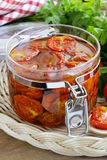 Sun-dried tomatoes with herbs and olive oil. In the pot Royalty Free Stock Photography