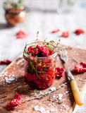 Sun dried tomatoes with herbs and olive oil Royalty Free Stock Image