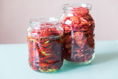 Sun dried tomatoes with herbs Stock Photos