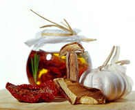 Sun dried tomatoes in jar with garlic Stock Photography
