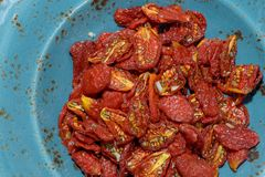 Sun-dried tomatoes. Lined textured dishes Stock Photo