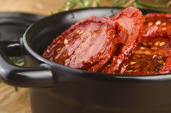 Sun dried tomatoes with olive Stock Images